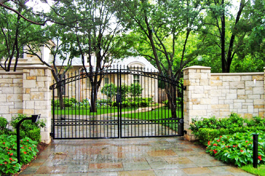 fence. iron gate with austin stone